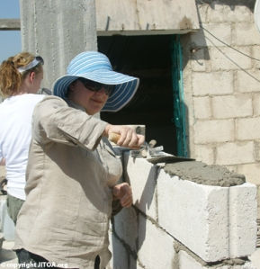 "Courtesy of VolunTourism. ""Laying Block with HfH Jordan"" Copyright © JITOA, All Rights Reserved"