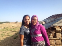 Amber and Ito in Tarmilaat village - 2013 Summer Service Program.