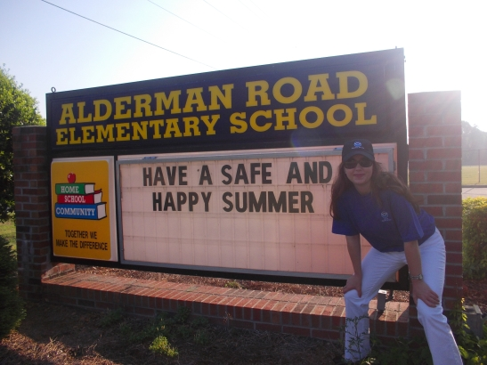 Me in front of our school marquee.