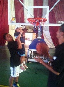 Me lifting up 6 year-old Rim for an alley-oop from AIESEC intern Wael Chaoui from Tunisia. For the Al-Akhawayn University Summer Camp, director Adil Kamane asked for an activity for an American culture day.