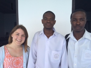 Brieanna Griffin is guided around the historic Tumekuja School by students Sharif Mohammed and Abdul Latif Juma.